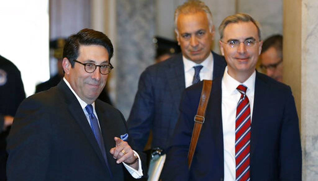 President Donald Trump's personal attorney Jay Sekulow, left, stands beside White House Counsel Pat Cipollone, right, at the Capitol in Washington on Jan. 22, 2020. (AP/Cortez)