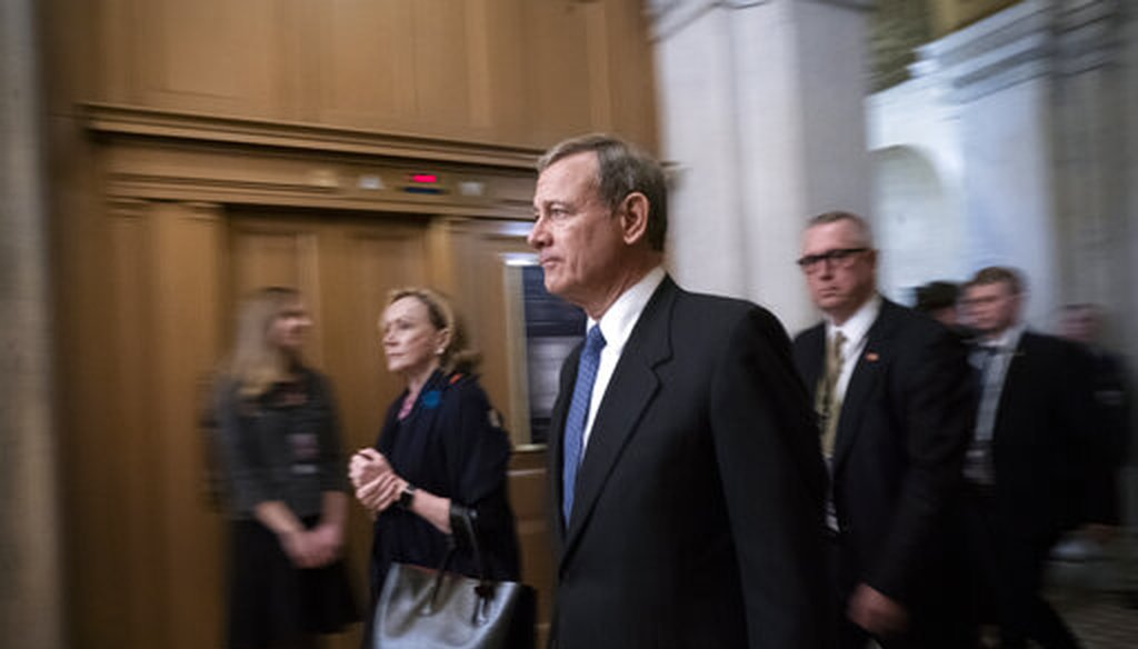 Chief Justice John Roberts leaves the Senate following arguments in the impeachment trial of President Donald Trump in Washington on Jan. 25, 2020. (AP/Applewhite)