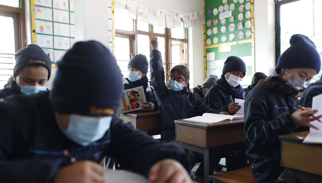 Students wear masks as a precautionary measure at Matribhumi school in Bhaktapur, Nepal, on Jan. 29, 2020. (AP)