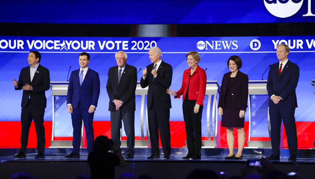Democratic presidential candidates on stage Friday, Feb. 7, 2020, before the start of a primary debate hosted by ABC News, Apple News, and WMUR-TV at Saint Anselm College in Manchester, N.H. (AP/Charles Krupa)
