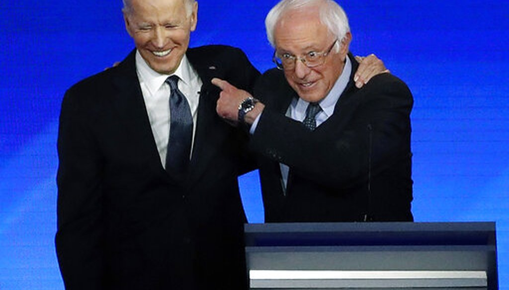 Former Vice President Joe Biden embraces Sen. Bernie Sanders, I-Vt., during a Democratic presidential primary debate, Feb. 7, 2020 at Saint Anselm College in Manchester, N.H. (AP/Elise Amendola)