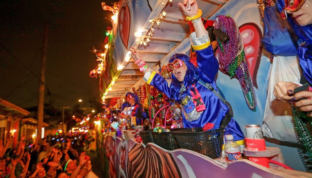 The Mystic Krewe of Nyx parade makes its way through the streets during Mardi Gras celebrations in New Orleans, Wednesday, Feb. 19, 2020. Carnival season culminated on Fat Tuesday, Feb. 25, 2020. (AP)