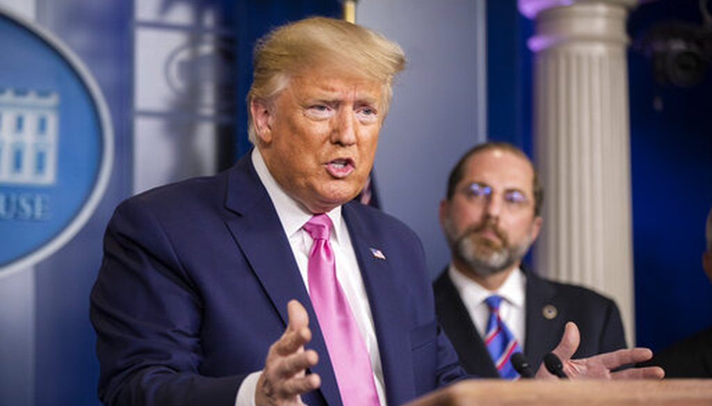 President Donald Trump, with Department of Health and Human Services Secretary Alex Azar to his right, speaks during a press conference on the coronavirus on Feb. 26, 2020 in Washington. (AP/Ceneta)
