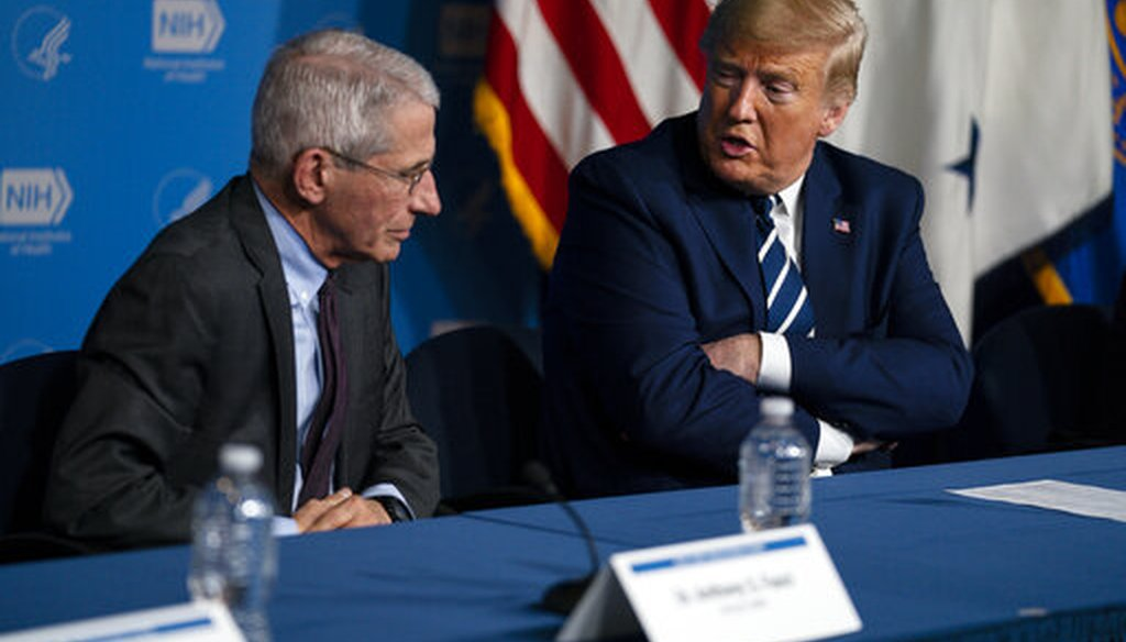 Dr. Anthony Fauci, director of the National Institute of Allergy and Infectious Diseases, listens as President Donald Trump speaks during a coronavirus briefing at the National Institutes of Health on March 3, 2020, in Bethesda, Maryland. (AP/Vucci)