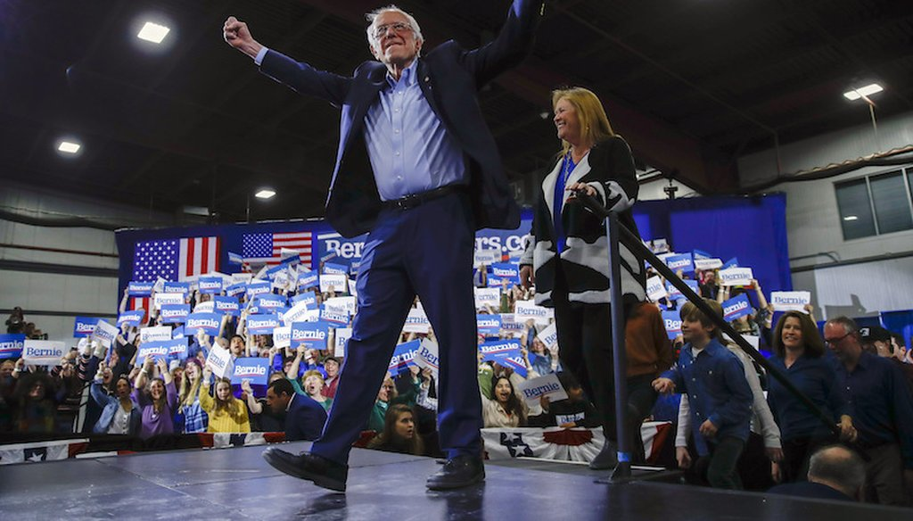 Democratic presidential candidate Sen. Bernie Sanders, I-Vt., accompanied by his wife Jane O'Meara Sanders, speaks during a primary night election rally in Essex Junction, Vt. (AP Photo/Matt Rourke)