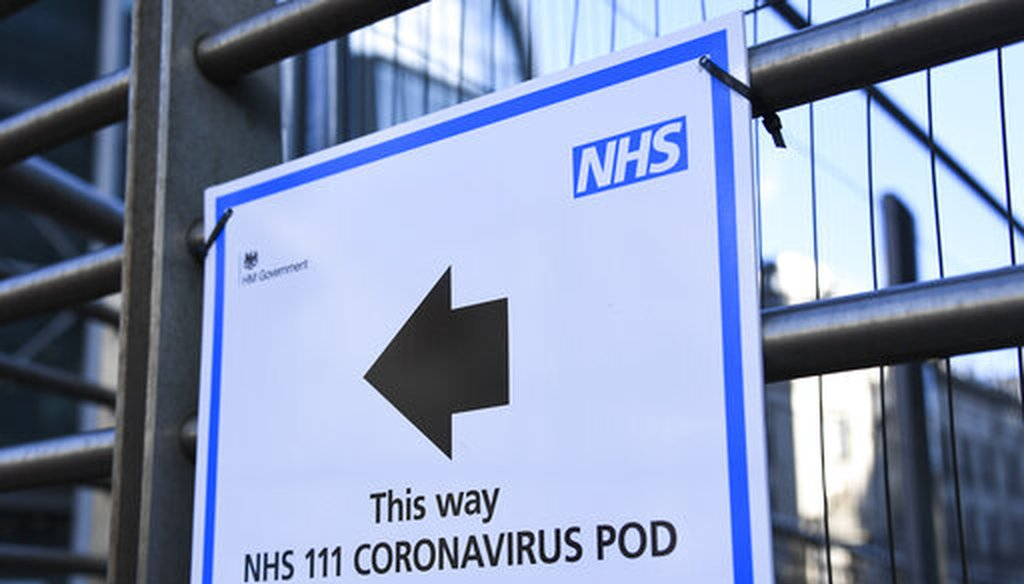 A sign indicating a coronavirus pod is seen outside the London University College Hospital in London on Friday, March 6, 2020. (AP/Pezzali)