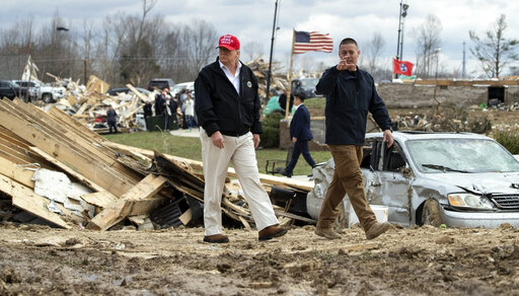President Donald Trump speaks with Mike Herrick, with Putnam County Rescue Squad, as he tours damage from a tornado on March 6, 2020, in Cookeville, Tenn. (AP)