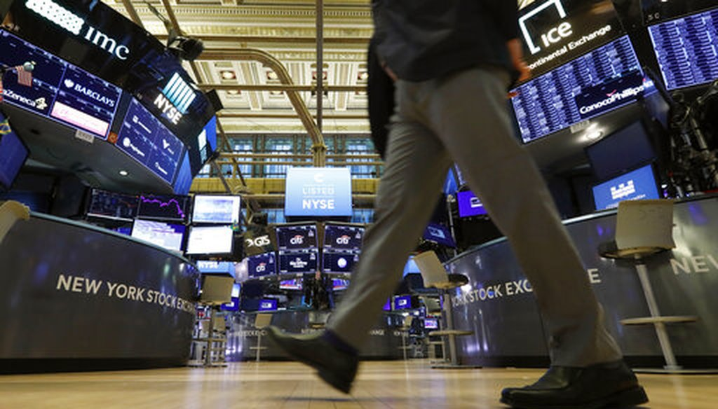 A trader walks across the floor of the New York Stock Exchange on March 9, 2020. (AP/Drew)