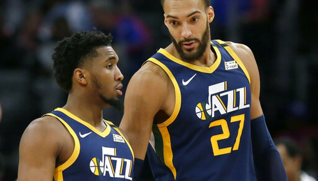 Utah Jazz center Rudy Gobert talks with guard Donovan Mitchell, left, during an NBA basketball game against the Detroit Pistons, in Detroit, on March 7, 2020. (AP/Burleson)