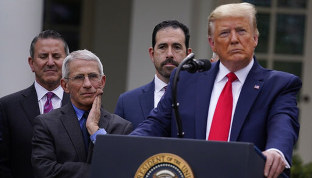 Dr. Anthony Fauci, director of the National Institute of Allergy and Infectious Diseases, and President Donald Trump listen during a coronavirus news conference at the White House on March 13, 2020, in Washington. (AP/Vucci)