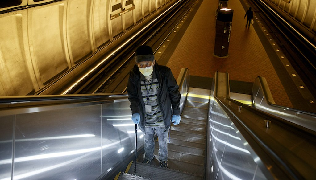 Andre of Washington, D.C., rides the escalator up at the Metro subway Congress Heights train station in Washington, Friday, March, 13, 2020. (Associated Press)