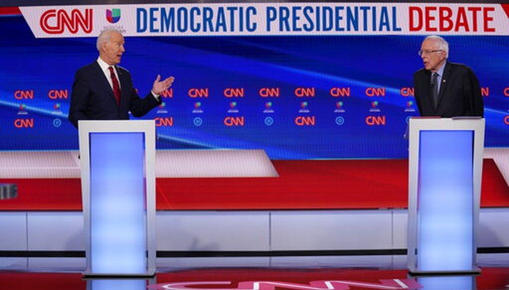 Former Vice President Joe Biden, left, and Sen. Bernie Sanders, I-Vt., right, participate in a Democratic presidential primary debate at CNN Studios in Washington, March 15, 2020. (AP/Evan Vucci)