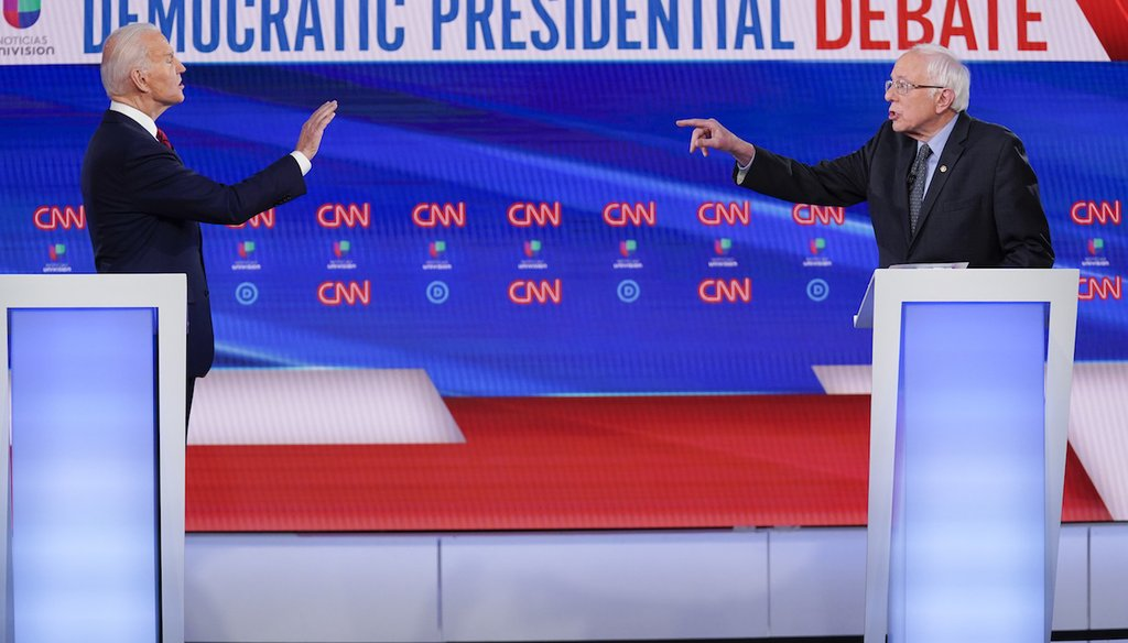 Former Vice President Joe Biden, left, and Sen. Bernie Sanders, I-Vt., right, participate in a Democratic presidential primary debate at CNN Studios in Washington, Sunday, March 15, 2020. (AP Photo/Evan Vucci)