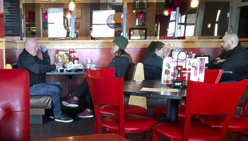 "A Red Robin restaurant in Tigard, Ore., has closed some tables in order to maintain ""social distancing"" between diners per CDC guidelines March 15. They said they were running the place at 50% capacity so they could leave tables empty. (AP)"