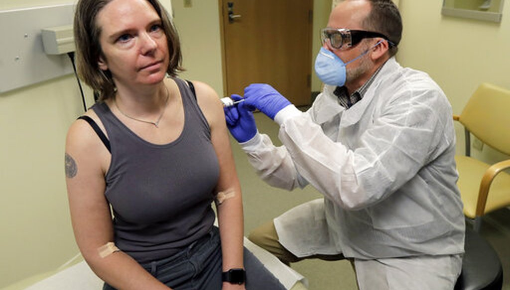 A pharmacist gives Jennifer Haller, left, the first shot in the clinical trial of a potential vaccine for COVID-19 on March 16, 2020, in Seattle. (AP)