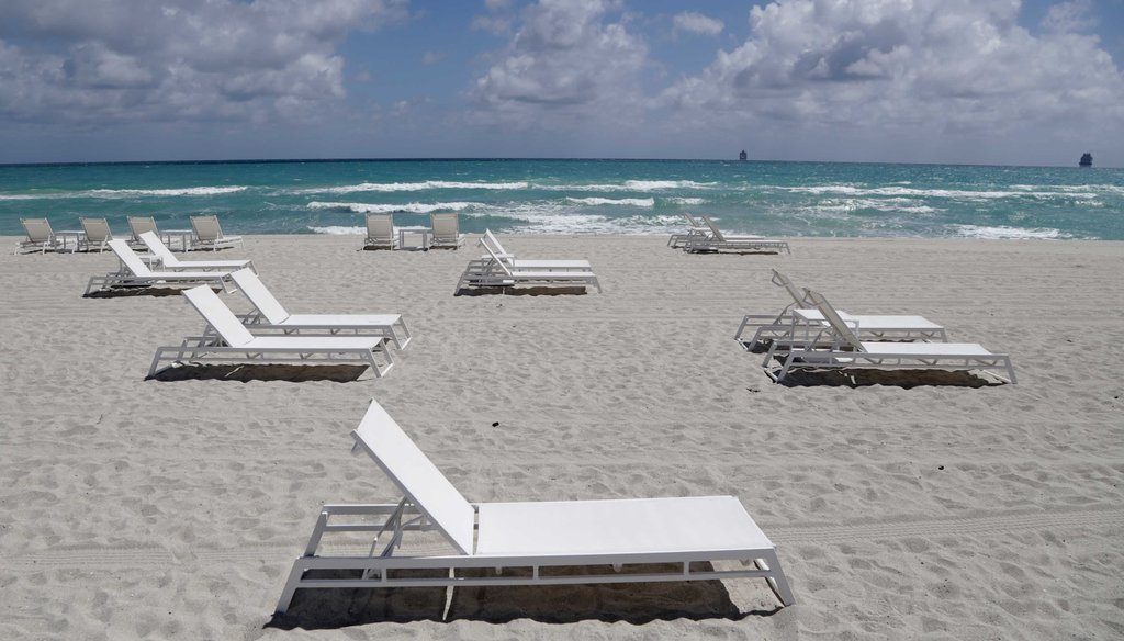 Empty chairs sit on the beach on March 19, 2020, in Miami Beach, Fla. (AP)