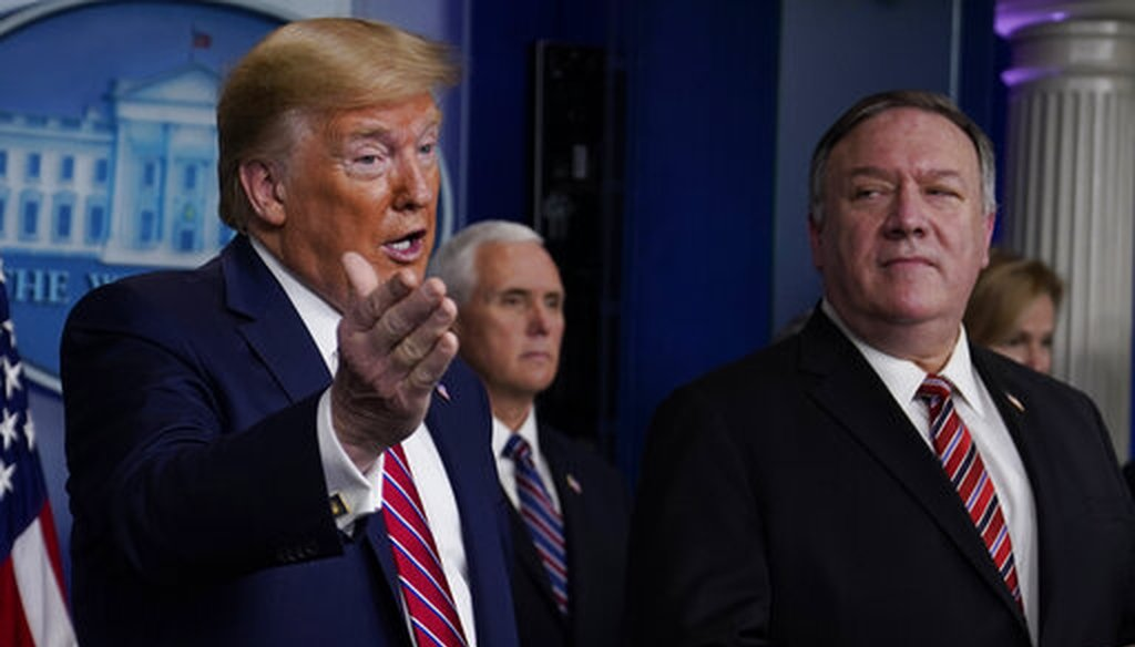 Secretary of State Mike Pompeo listens as President Donald Trump speaks during a coronavirus task force briefing at the White House on March 20, 2020, in Washington. (AP/Vucci)