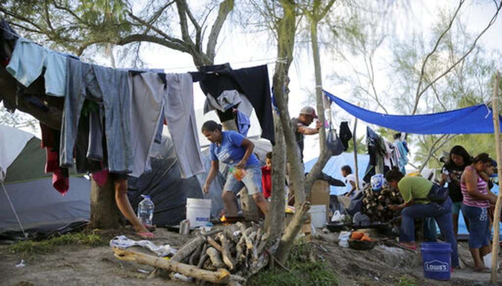 In this Nov. 5, 2019 photo, migrants live in a refugee camp in Matamoros, Mexico. Asylum-seekers waiting in Mexico for court hearings in the U.S. appeared before a judge to explain why, after months of effort, they couldn't find an attorney. (AP/Eric Gay)