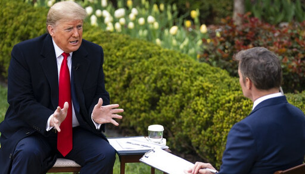 President Donald Trump talks with host Bill Hemmer during a Fox News virtual town hall with members of the coronavirus task force, in the Rose Garden at the White House, March 24, 2020, in Washington. (AP/Evan Vucci)
