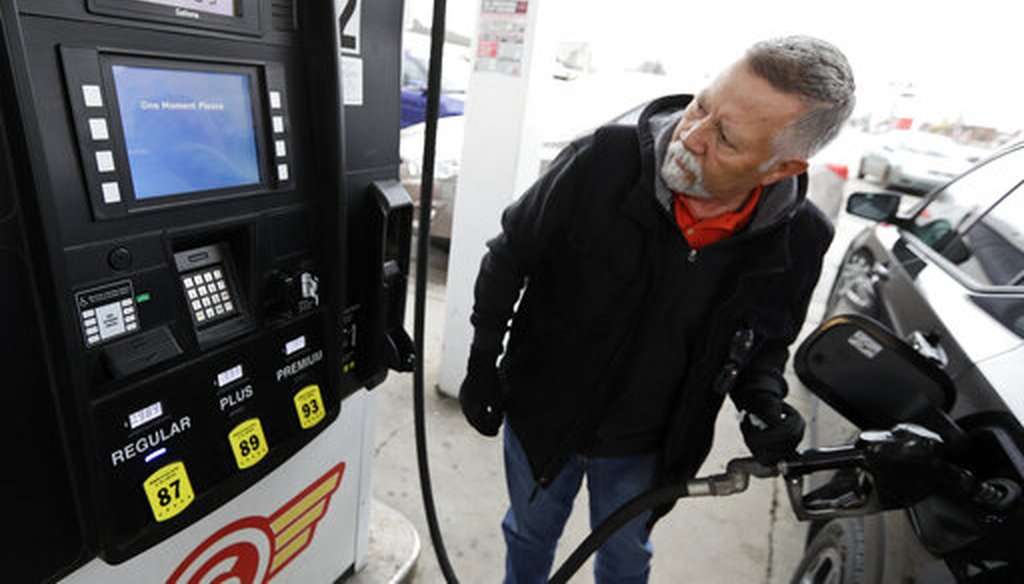 Julio DeJesus pumps gas for 98.9 cents a gallon on March 30, 2020, in Cleveland. (AP)