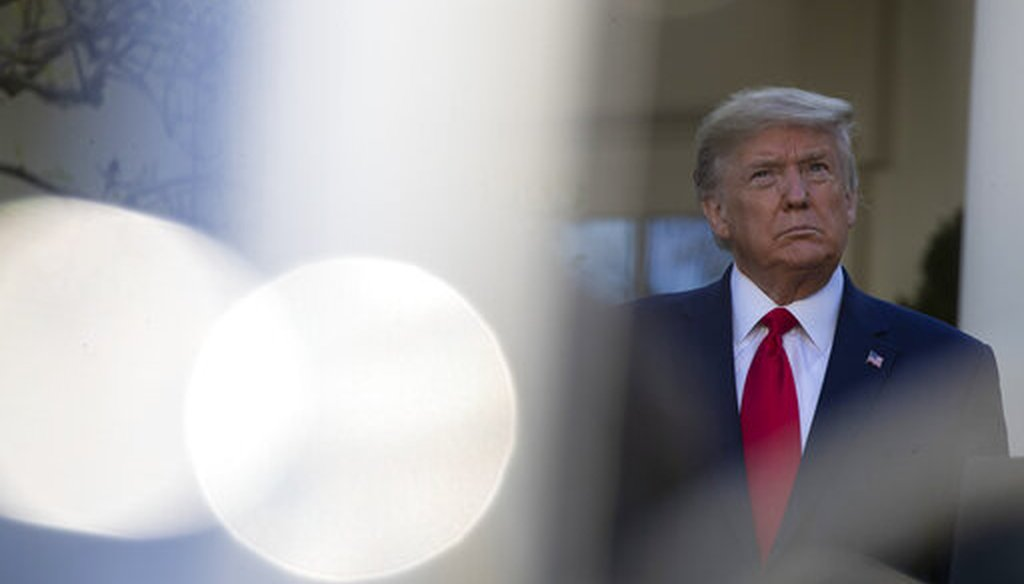 President Donald Trump stands as others speak about the coronavirus at the White House on March 30, 2020, in Washington. (AP/Brandon)