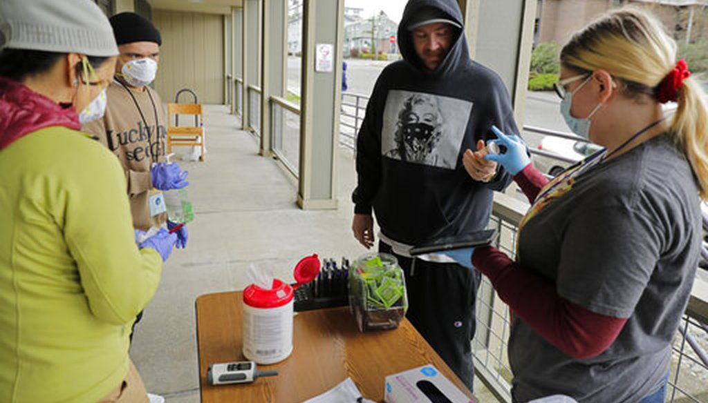 A patient picks up medication for opioid addiction at a clinic in Olympia, Wash., on March 27, 2020. The clinic is meeting patients outdoors and offering longer prescriptions during the coronavirus pandemic. (AP)