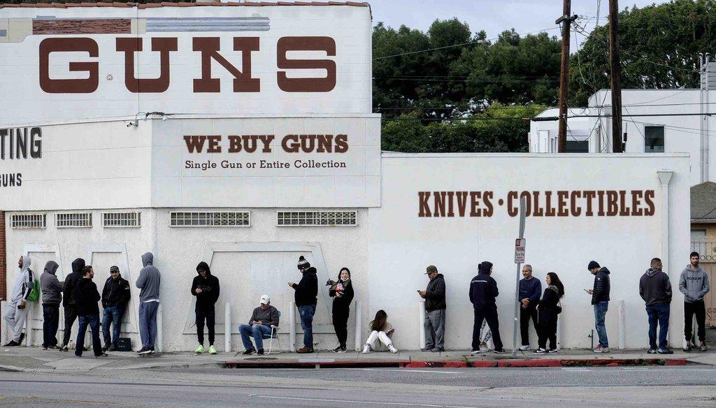In this March 15, 2020, file photo, people wait in line to enter a gun store in Culver City, Calif. (AP)