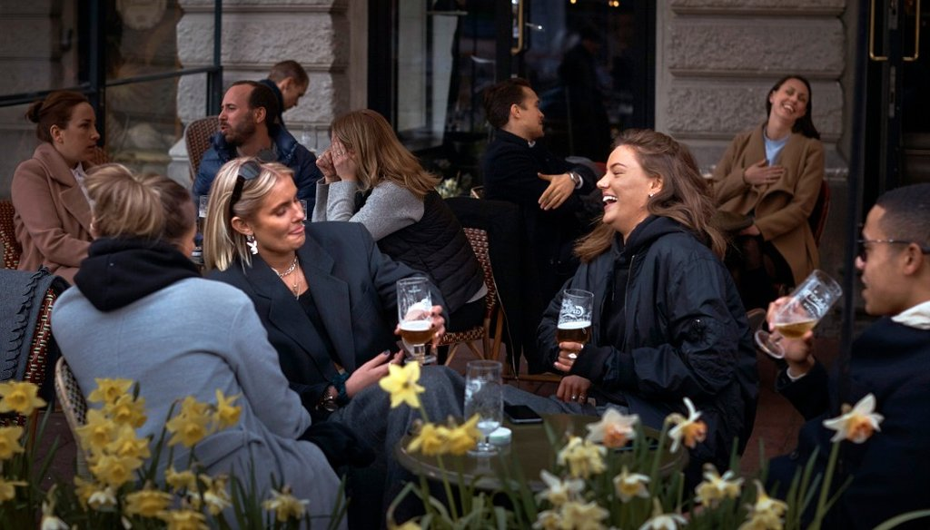 In this Wednesday, April 8, 2020 file photo people chat and drink outside a bar in Stockholm, Sweden. Sweden is pursuing relatively liberal policies to fight the coronavirus pandemic, even though there has been a sharp spike in deaths. (AP)