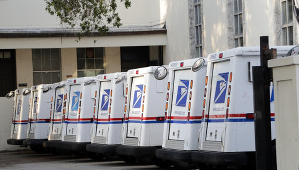 U.S. Postal Service trucks are lined up on April 13, 2020, in Miami Beach, Florida. (AP/Sladky)