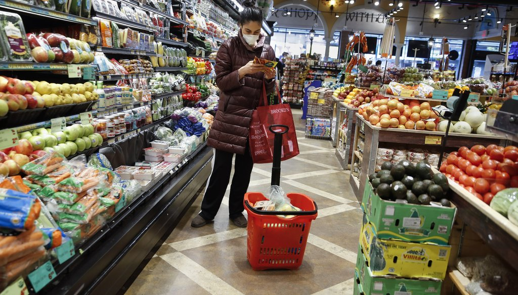 A shopper wears a face mask in the produce section of a grocery store April 18, 2020, in the Harlem neighborhood of the Manhattan borough of New York, during the coronavirus outbreak. (AP)