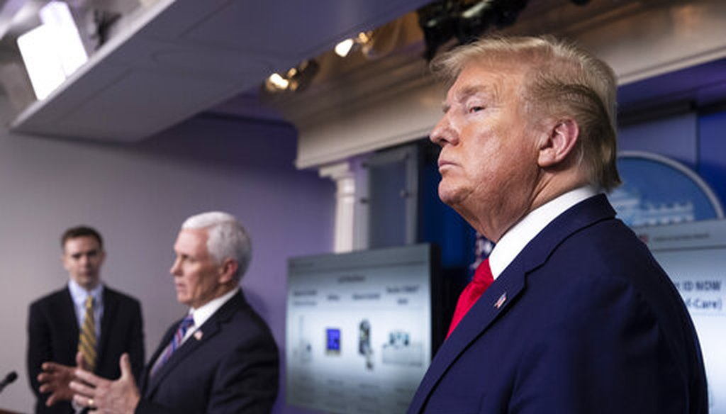 President Donald Trump stands as Vice President Mike Pence speaks about the coronavirus in the James Brady Press Briefing Room of the White House, Monday, April 20, 2020. AP Photo/Alex Brandon