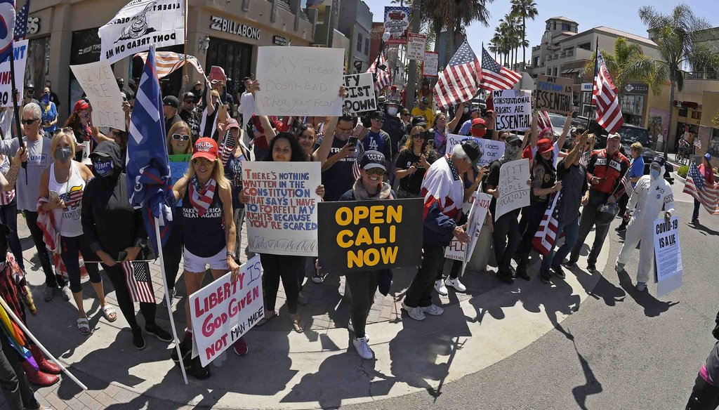 In this April 17, 2020, file photo, protesters demonstrate against stay-at-home orders that were put in place due to the COVID-19 outbreak, in Huntington Beach, Calif. (AP)