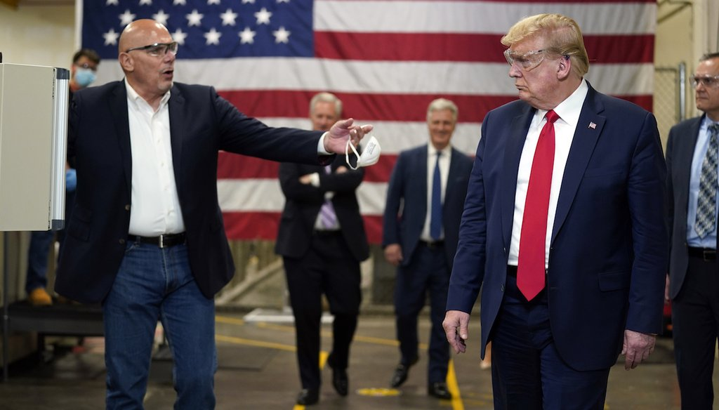 President Donald Trump participates in a tour of a Honeywell International plant that manufactures personal protective equipment,  May 5, 2020, in Phoenix. (AP)