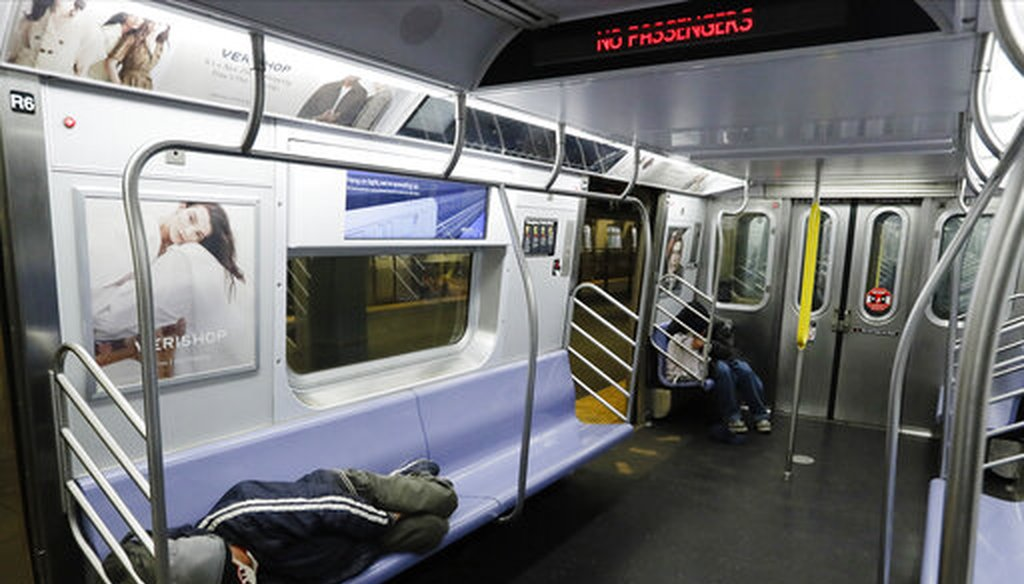 Homeless New Yorkers sleep on a train in Brooklyn on May 6, 2020. (AP)