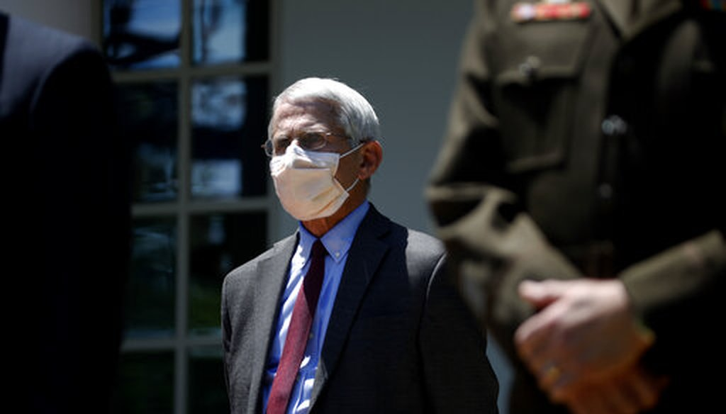 Dr. Anthony Fauci, director of the National Institute of Allergy and Infectious Diseases, listens as President Donald Trump speaks about the coronavirus in the Rose Garden of the White House on May 15, 2020. (AP)