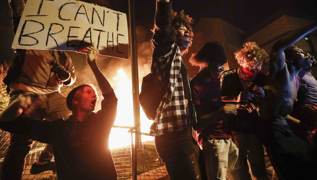 Protestors demonstrate outside of a burning Minneapolis 3rd Police Precinct on May 28, 2020, in Minneapolis. (AP)