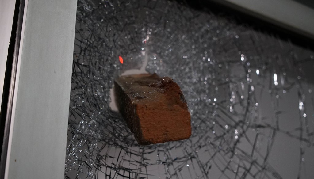 A brick protrudes from a shattered window in downtown Raleigh, N.C., on June 1, 2020. (AP)