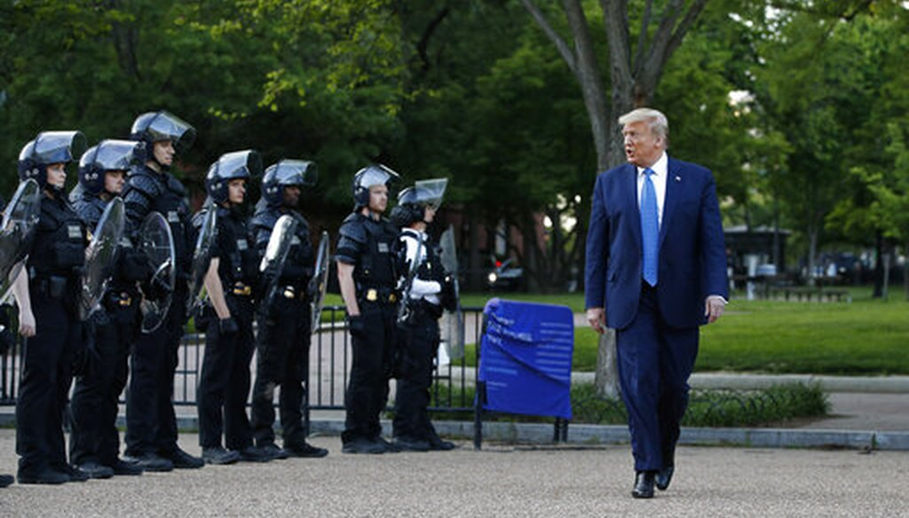 President Donald Trump walks past police in Lafayette Park across from the White House on June 1, 2020. (AP)