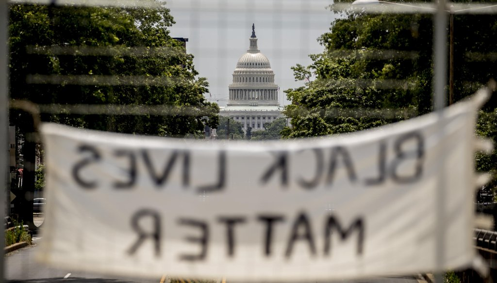 "The dome of the U.S. Capitol is visible as a sign that reads ""Black Lives Matter"" hangs on an overpass on North Capitol Street in Washington on June 2, 2020. (AP)"