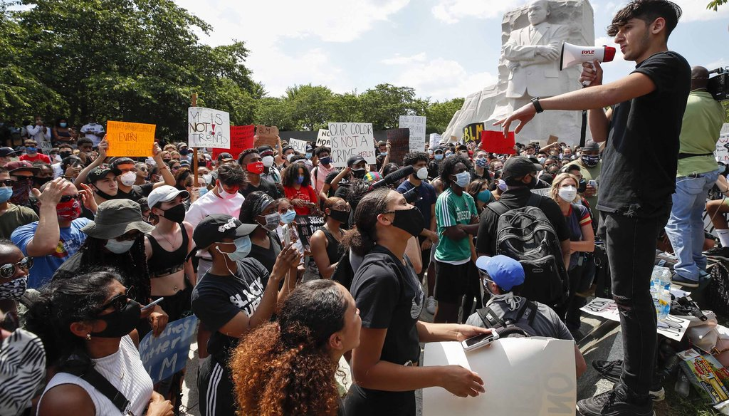 Demonstrators protest on June 4, 2020, at the Martin Luther King Jr. Memorial in Washington, over the death of George Floyd. (AP)