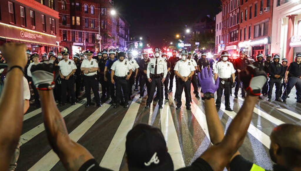 Protesters take a knee on Flatbush Avenue in front of New York City police officers during a solidarity rally for George Floyd on June 4, 2020, in the Brooklyn borough of New York. (AP)