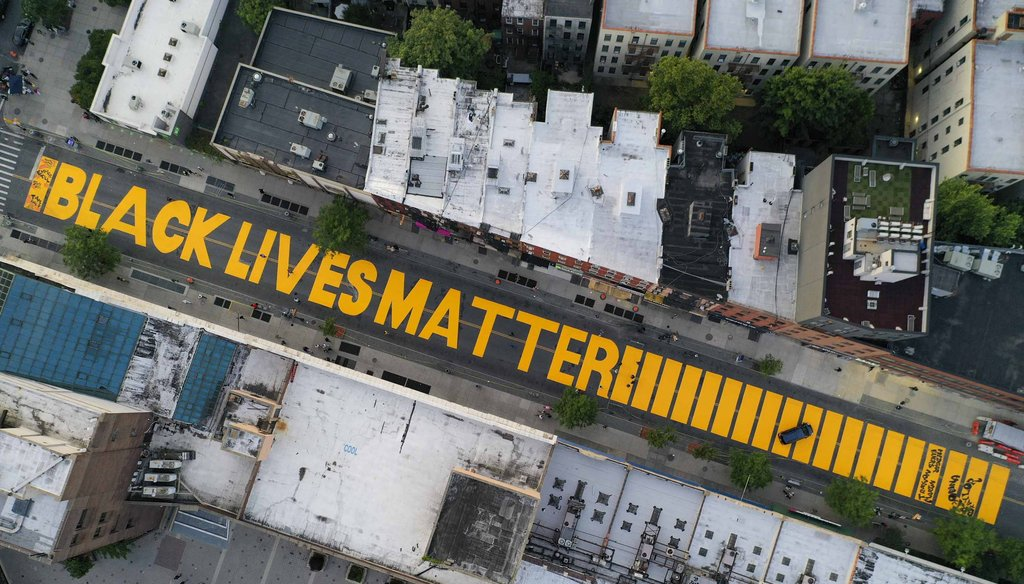 "A giant ""BLACK LIVES MATTER"" sign is painted in orange on Fulton Street on June 15, 2020, in the Brooklyn borough of New York. (AP)"