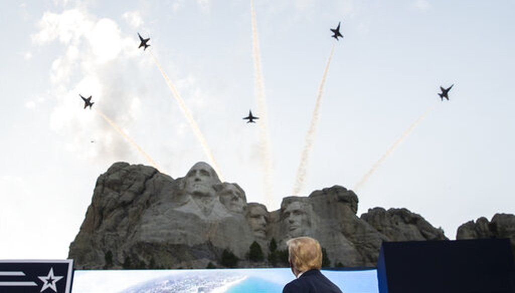 President Donald Trump watches a flyover by the U.S. Navy Blue Angels at Mount Rushmore National Memorial on July 3, 2020. (AP)