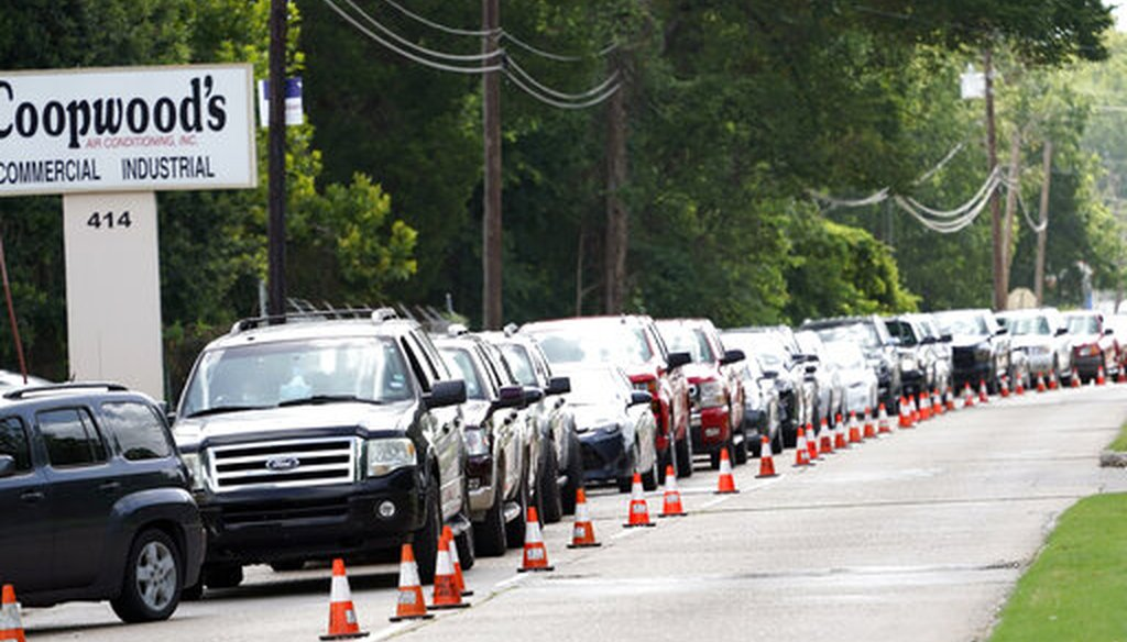 People wait inside their vehicles in line at COVID-19 testing site on July 8, 2020, in Houston. (AP)