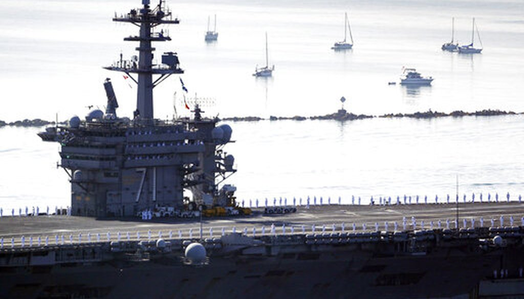 Sailors man the rails as the USS Theodore Roosevelt aircraft carrier makes its way into San Diego Bay on July 9, 2020. The carrier returned to San Diego after a massive COVID-19 outbreak on board. (AP)
