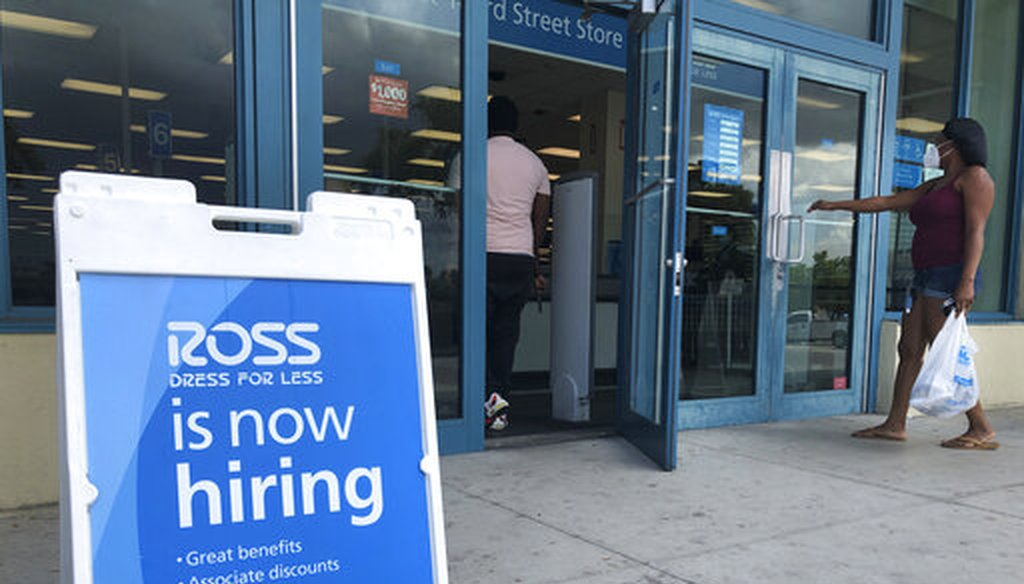 "A ""Now Hiring"" sign sits outside a Ross Dress for Less store in North Miami Beach, Fla., on July 8, 2020. (AP)"