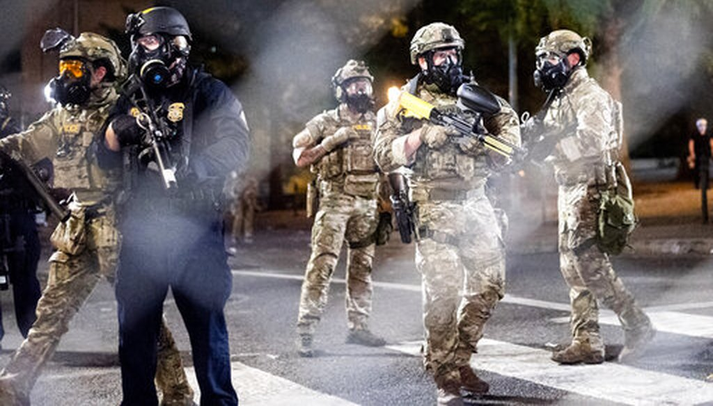 Federal agents disperse protesters near the Mark O. Hatfield United States Courthouse on July 20, 2020, in Portland, Ore. (AP/Berger)