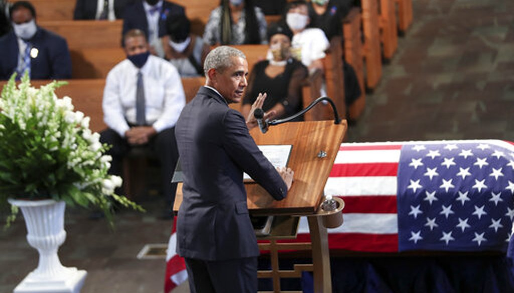 Former President Barack Obama eulogizes Rep. John Lewis at Ebenezer Baptist Church in Atlanta, July 30. (Alyssa Pointer/Atlanta Journal-Constitution via AP)