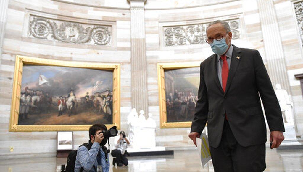 Senate Minority Leader Sen. Chuck Schumer of N.Y., walks through the Rotunda on Capitol Hill in Washington, Aug. 3, 2020. (AP/Susan Walsh)