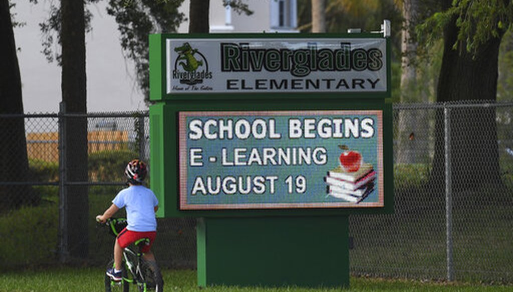 A sign outside a Broward County, Fla., elementary school advertises the start of virtual learning. (AP)